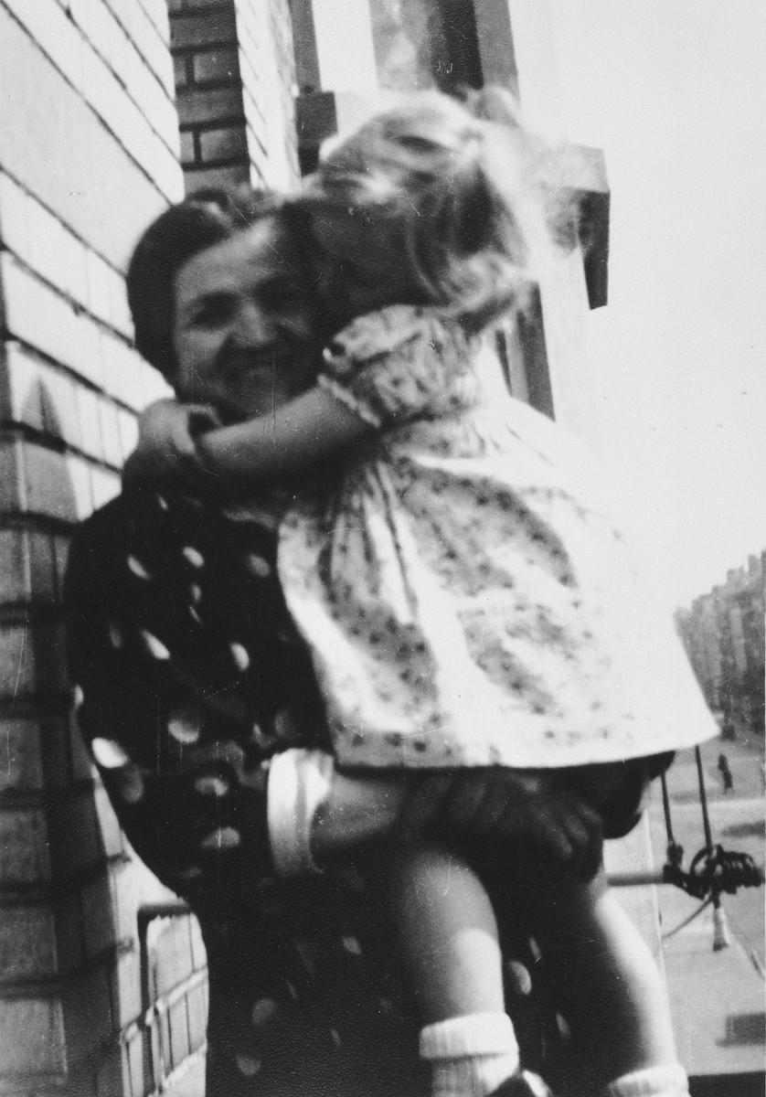 Rivke Orenbuch holds her young granddaughter, Josiane Aizenberg.