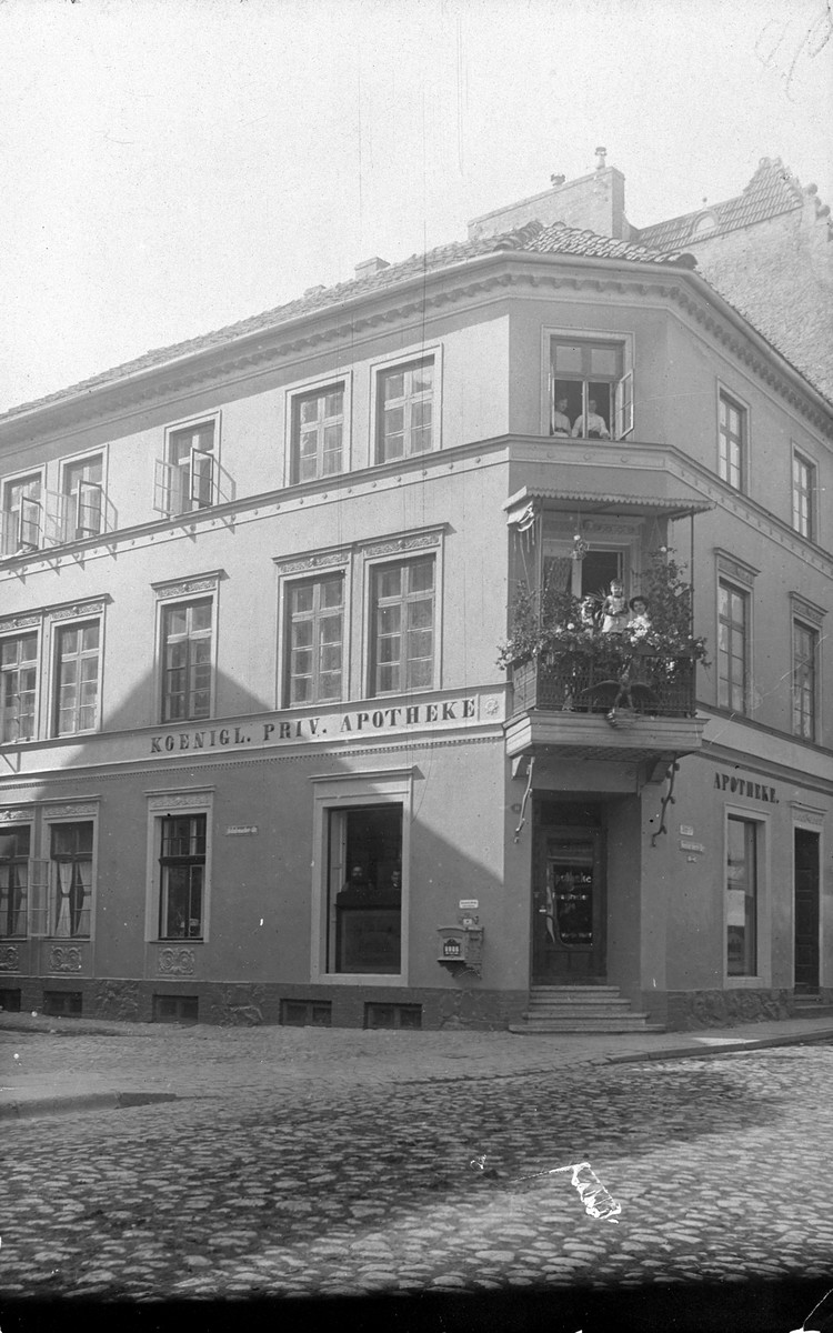 The Neustadt Pharmacy of Martin Wolff in Braunsberg, Germany (East Prussia).   The family lived in the house upstairs, and the people shown on the balcony may be Martin, Paula and Hans Wolff.