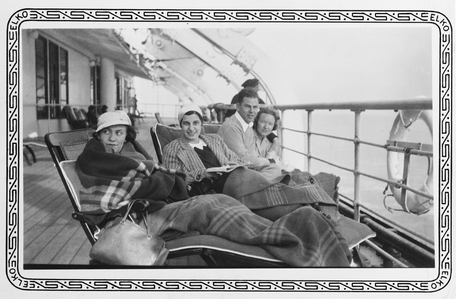 Passengers sit on the deck of the Lafayette during their voyage to the United States.  Among those pictured is Hildegard Wolff (second from left).