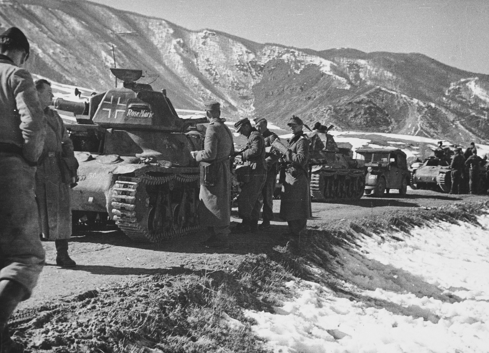 "A line of German tanks from the ""Prinz Eugen"" Division stop on a road in snow covered Bosnia.  Among those pictured are: Commander of Pioneer Bataillon, SS-Obersturmbannfuehrer Zimmermann.  This is one of a collection of photographs from Friedrich Wilhelm Krueger, commander of the ""Prinz Eugen"" Division."
