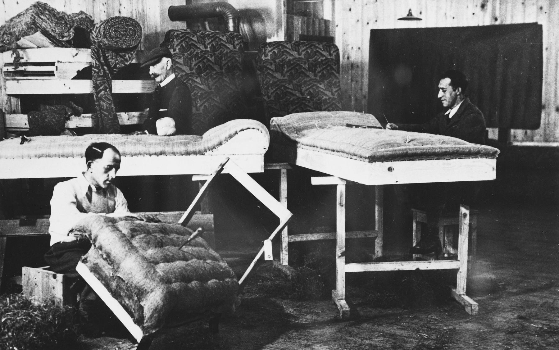 Prisoners upholster furniture at a Slovak labor camp.