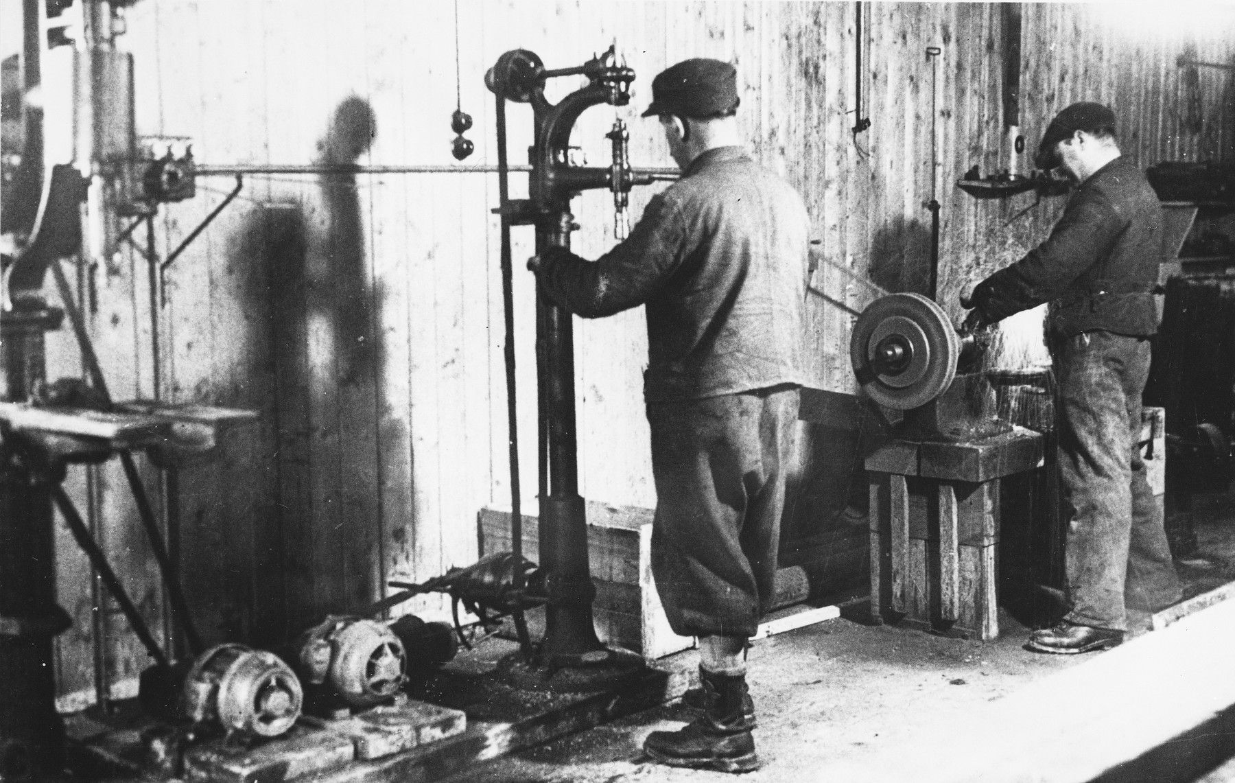 Prisoners work in a machine shop at a Slovak labor camp.