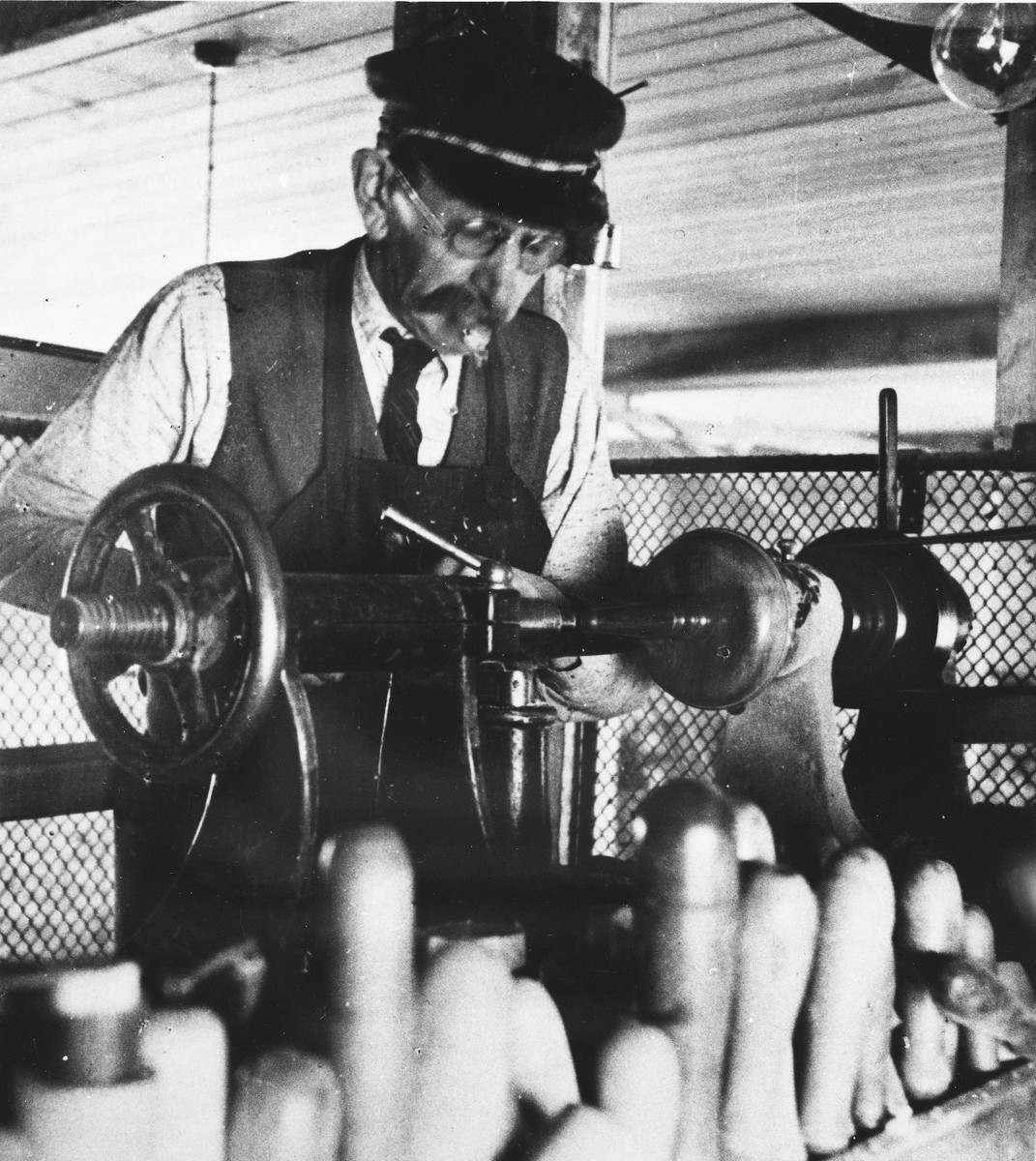 A prisoner works in a machine shop at a Slovak labor camp.