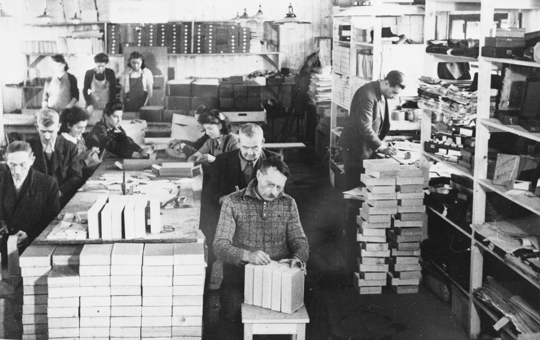 Prisoners make boxes at a Slovak labor camp.