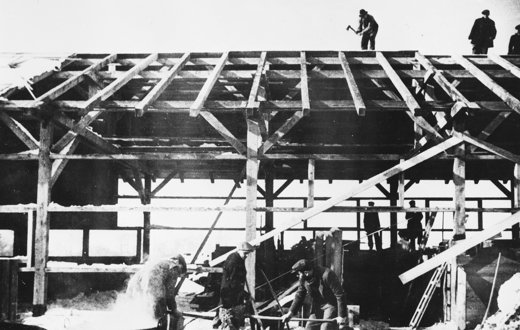 Prisoners construct barracks and other buildings at a Slovak labor camp.