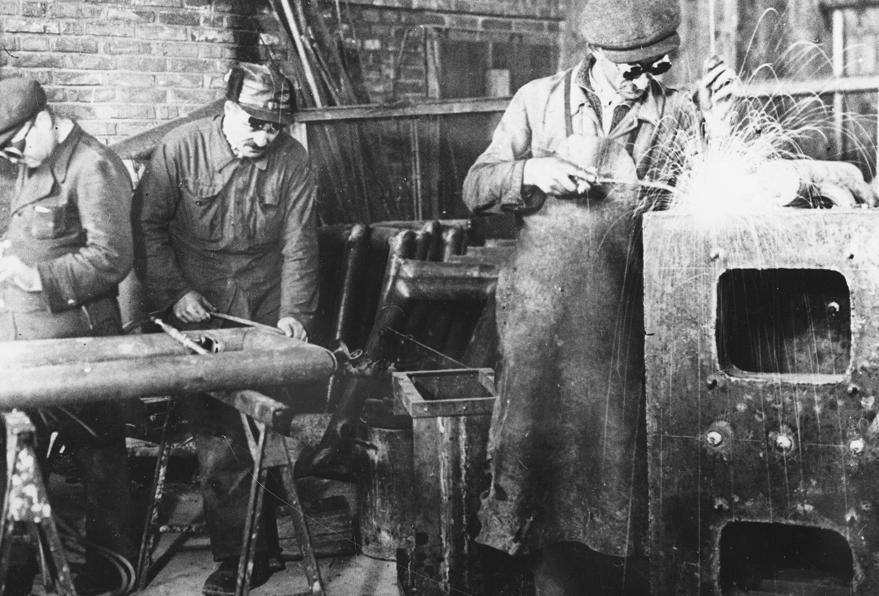 Prisoners weld metal at a Slovak labor camp.