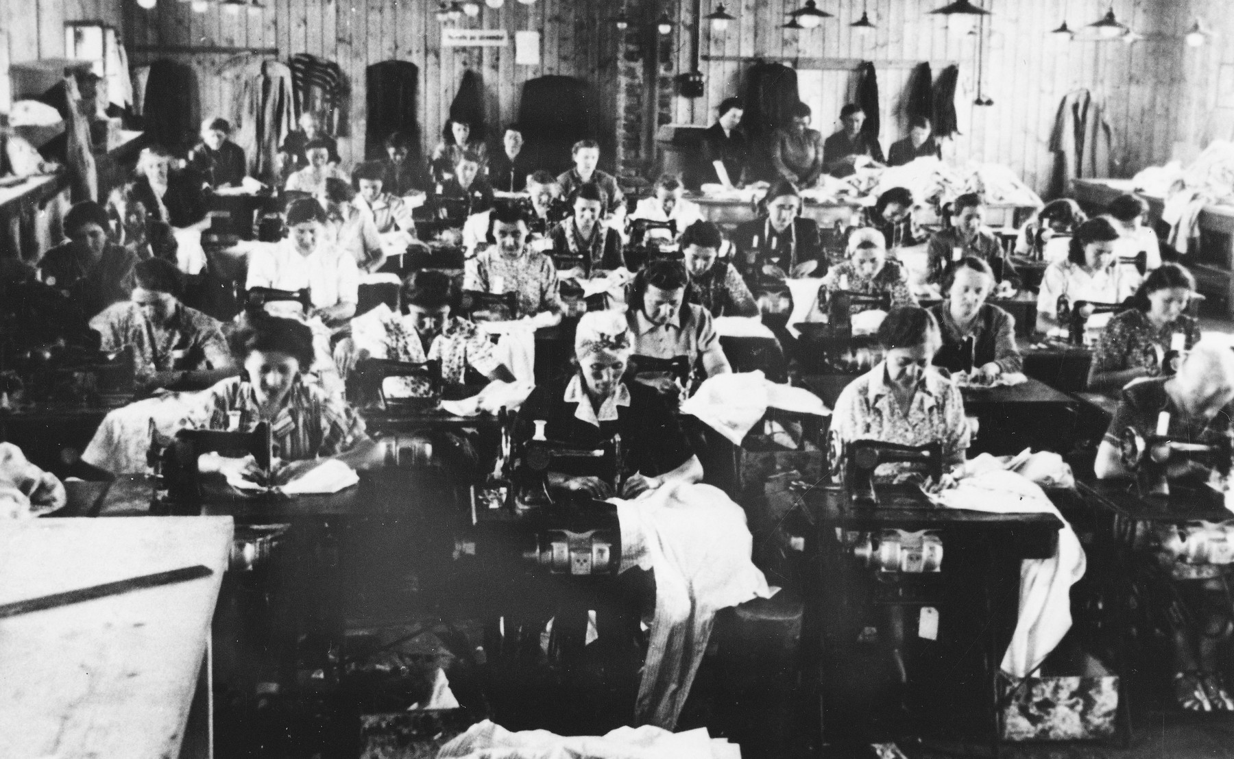 Prisoners sew clothing at a Slovak labor camp.