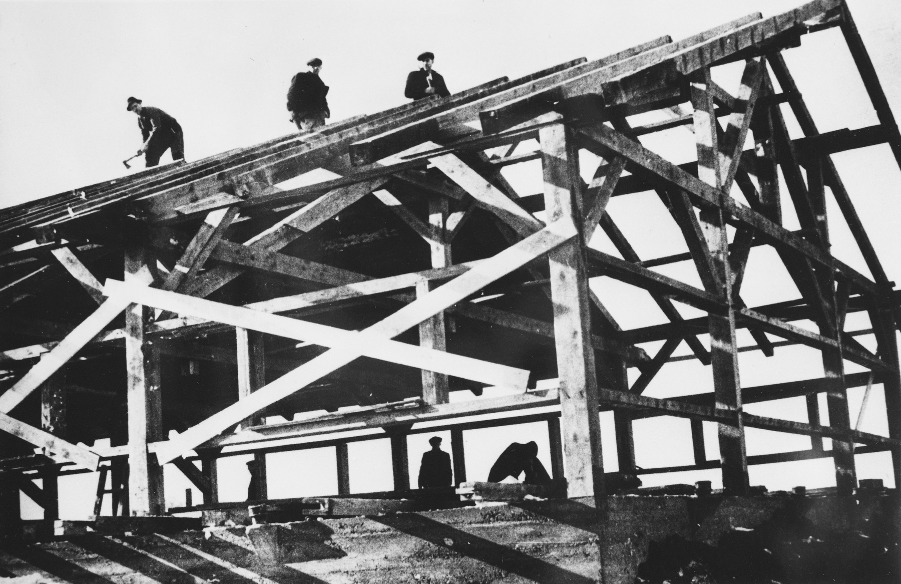 Prisoners from the Sixth Labor Battalion build their own barracks at a Slovak labor camp.