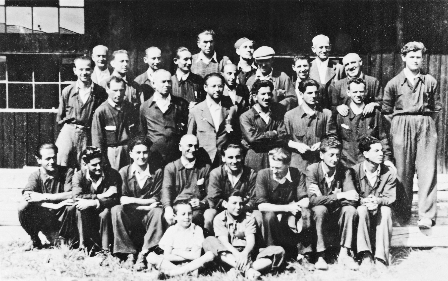 Prisoners from the Sixth Labor Battalion at a Slovak labor camp.  Among those pictured is Pali Ardo sitting, second from the right, in the second row.
