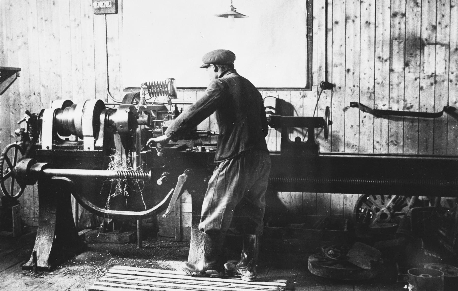 Prisoners work in a machine shop at a Slovak labor camp.