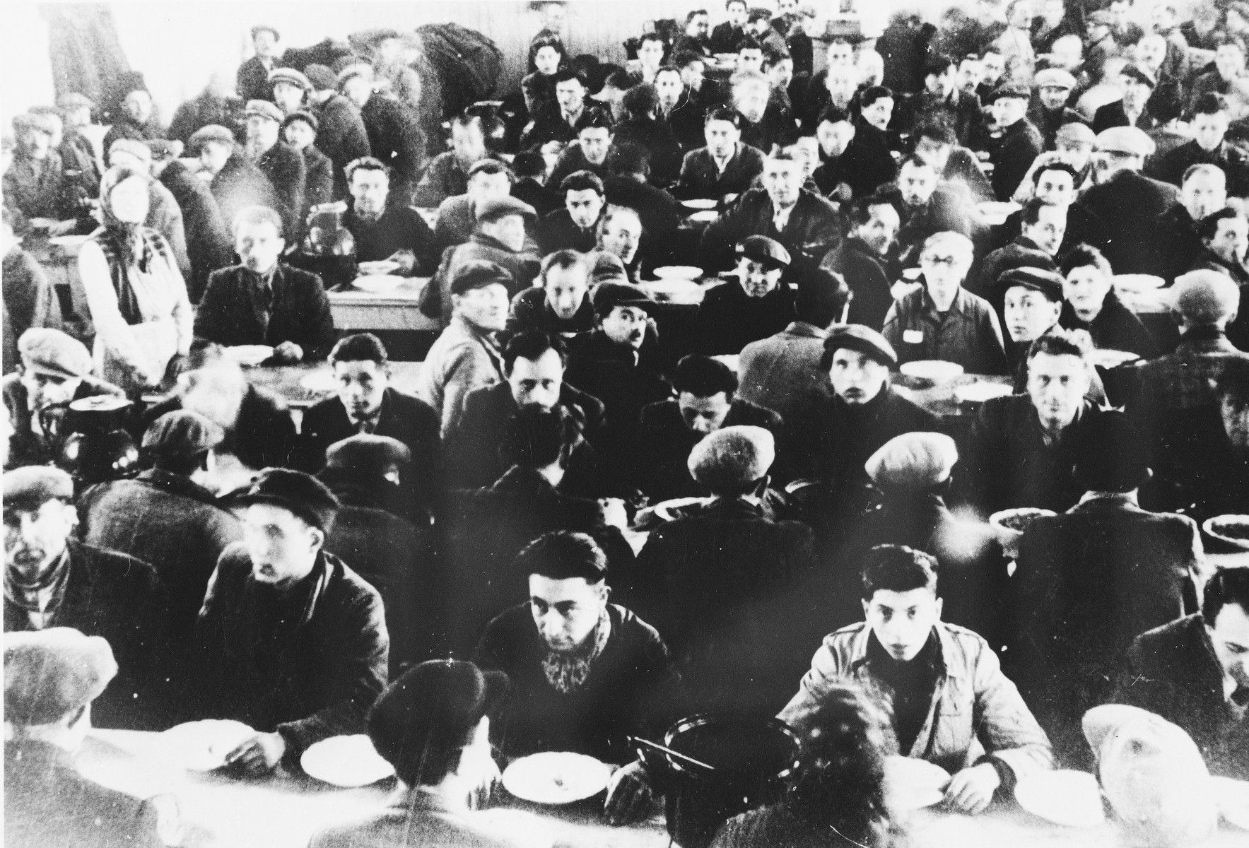 Prisoners eat in the cafeteria at a Slovak labor camp.