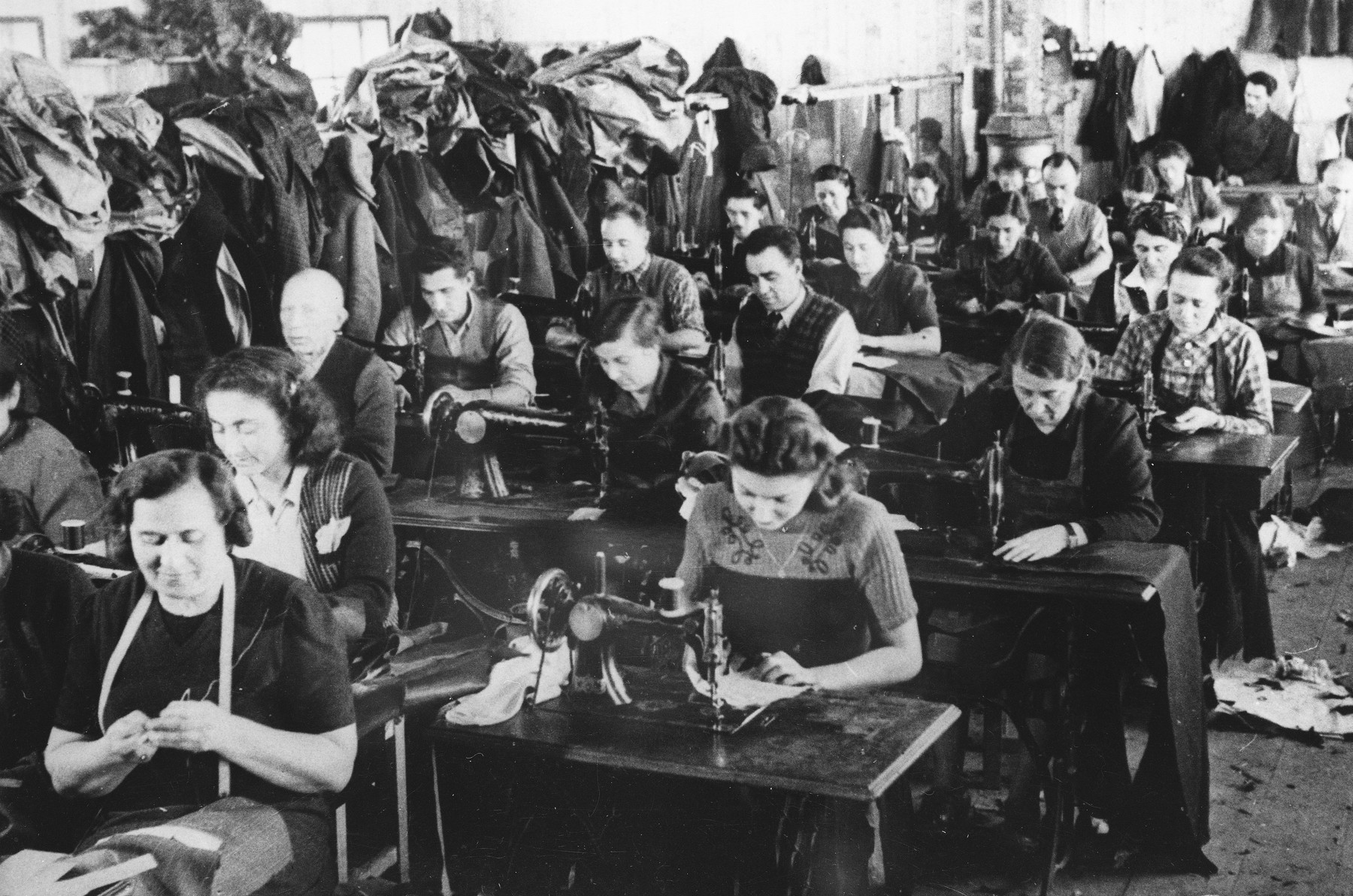 Prisoners operate sewing machines at a Slovak labor camp.