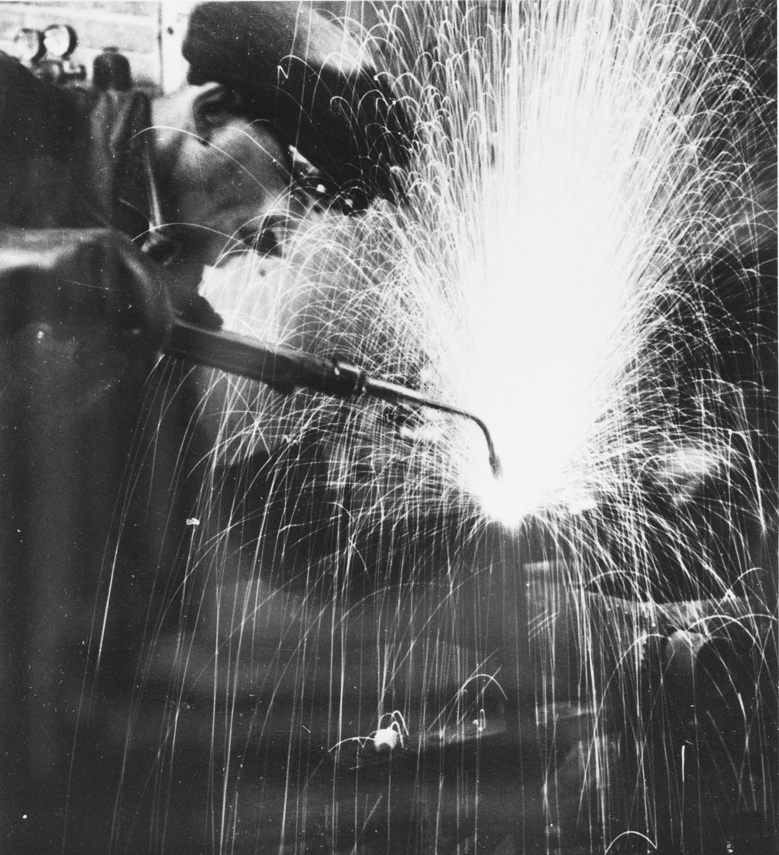 A prisoner welds metal at a Slovak labor camp.