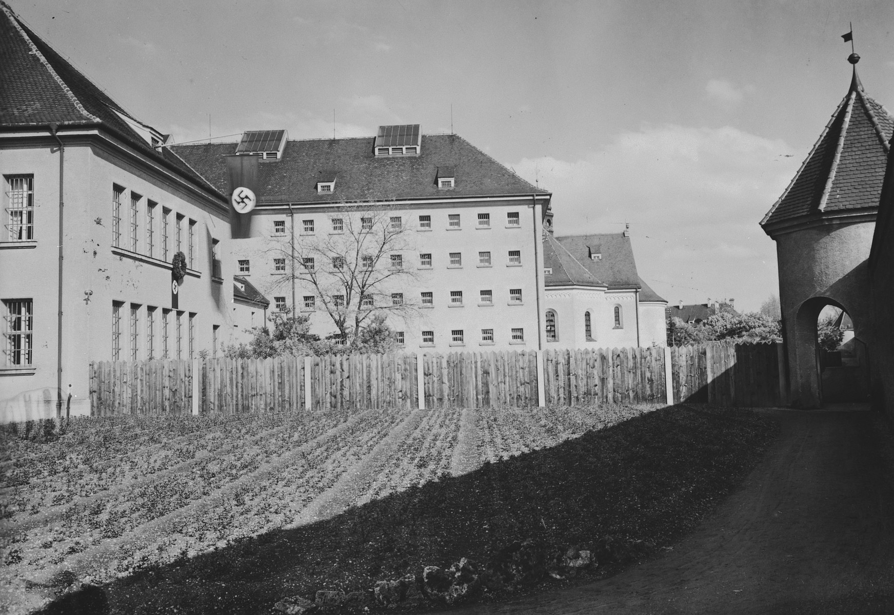 A banner with a large swastika hangs from the roof the Landsberg prison.