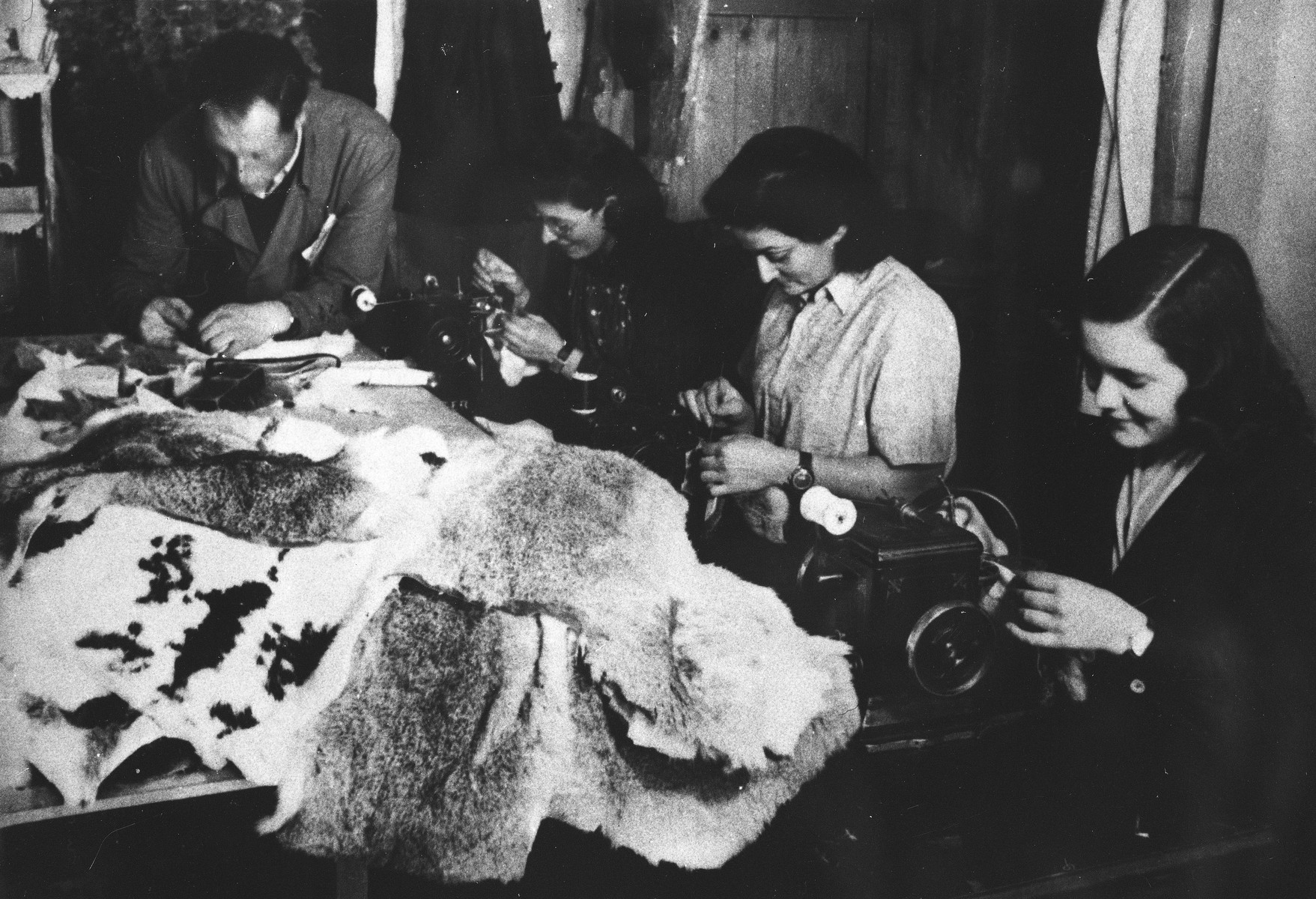 Prisoners sew coats from animal pelts at a Slovak labor camp.