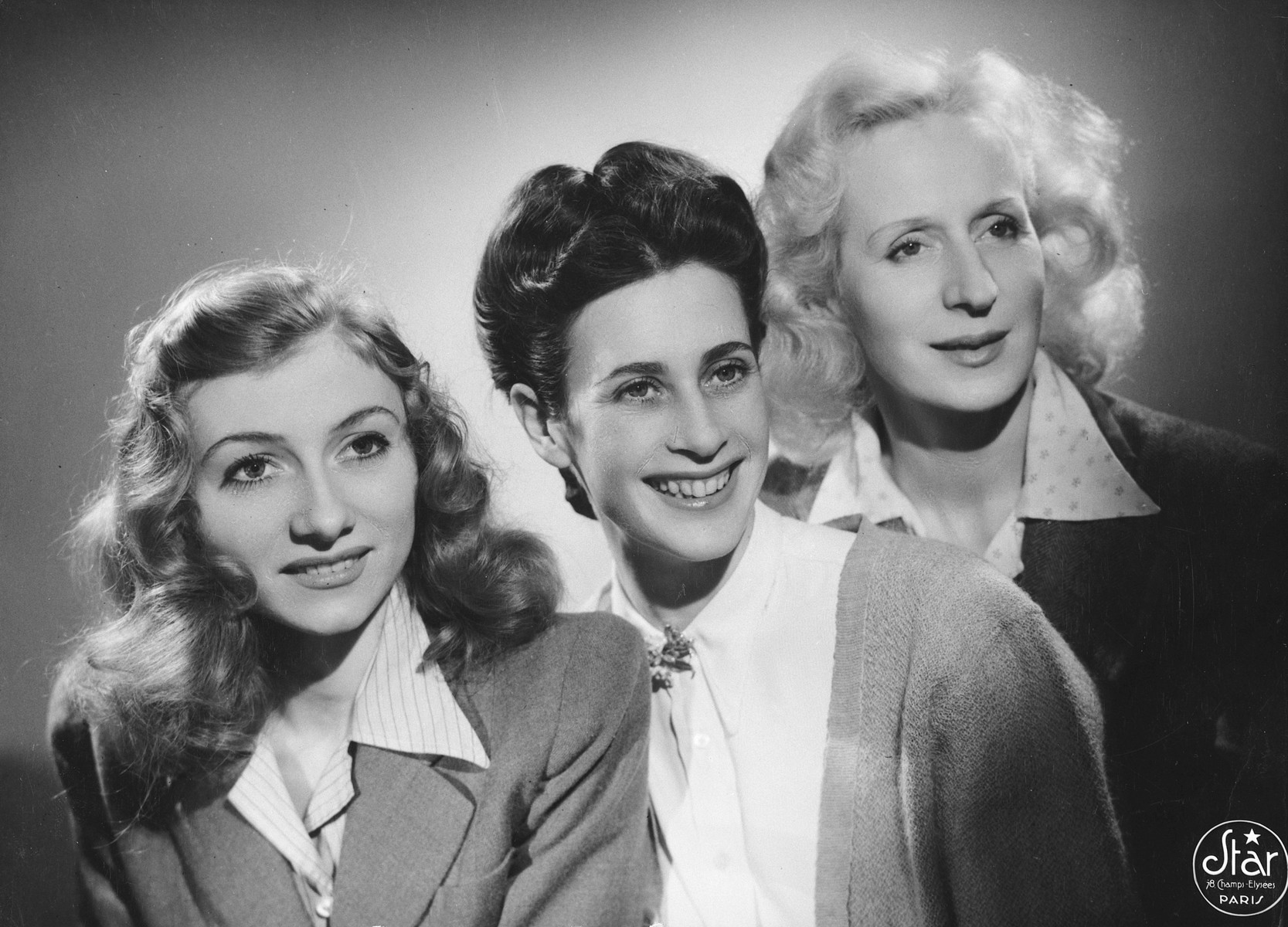 Studio portrait of three dancers in Paris, one of whom is a Jew in hiding.  Pictured in the center is Sadie Rigal.