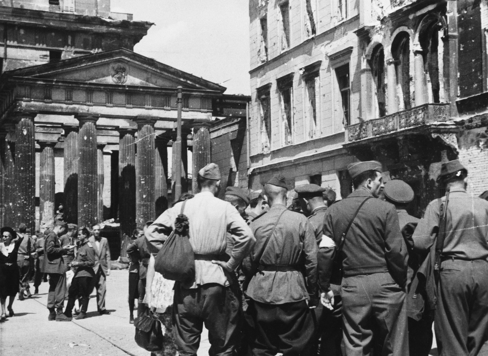 Soviet soldiers gather on a street in Berlin shortly after its capture.