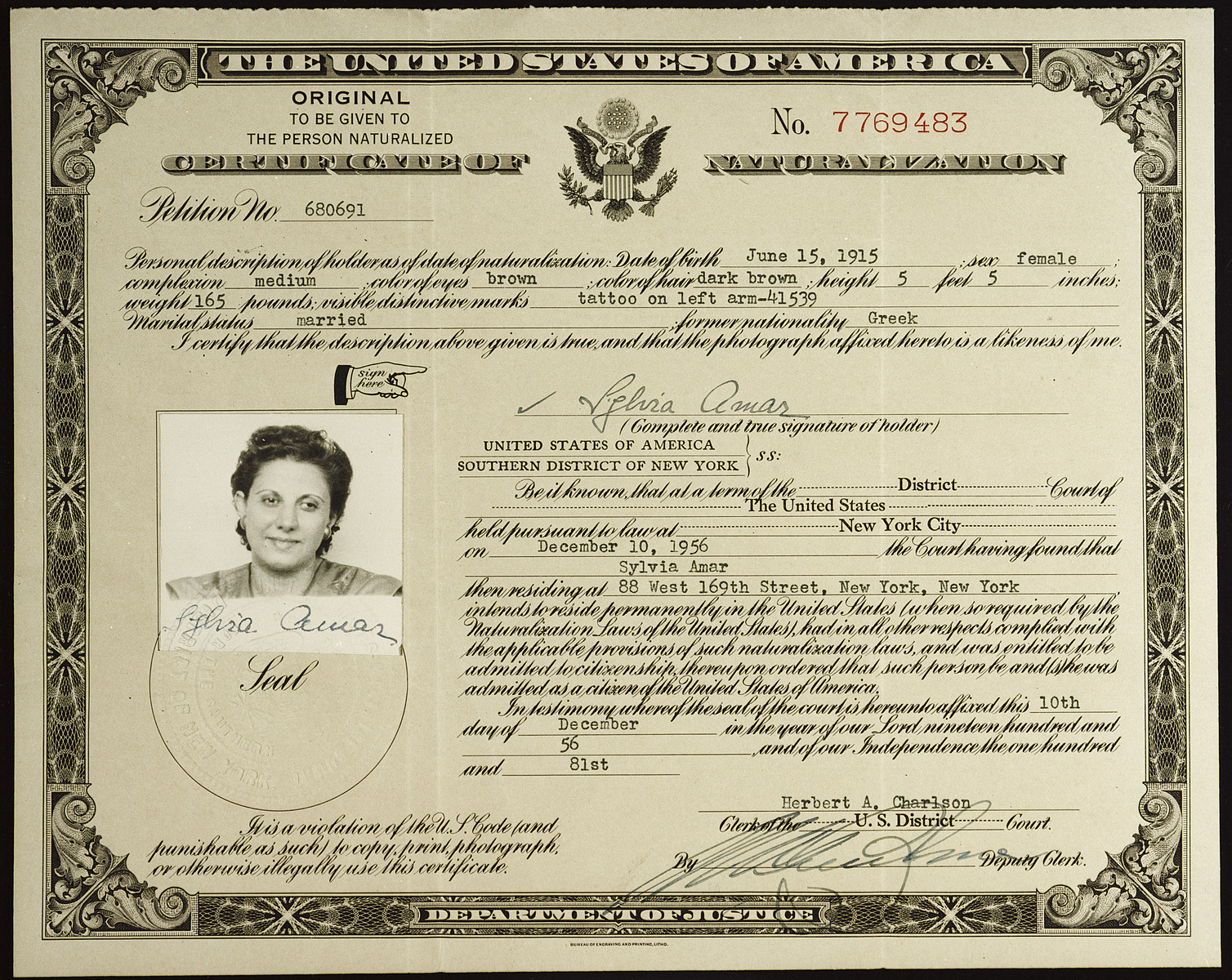 Naturalization certificate issued to Sylvia Amar, a Greek-Jewish immigrant.  On the line marked visible distinctive marks is written her Auschwitz tattoo number.