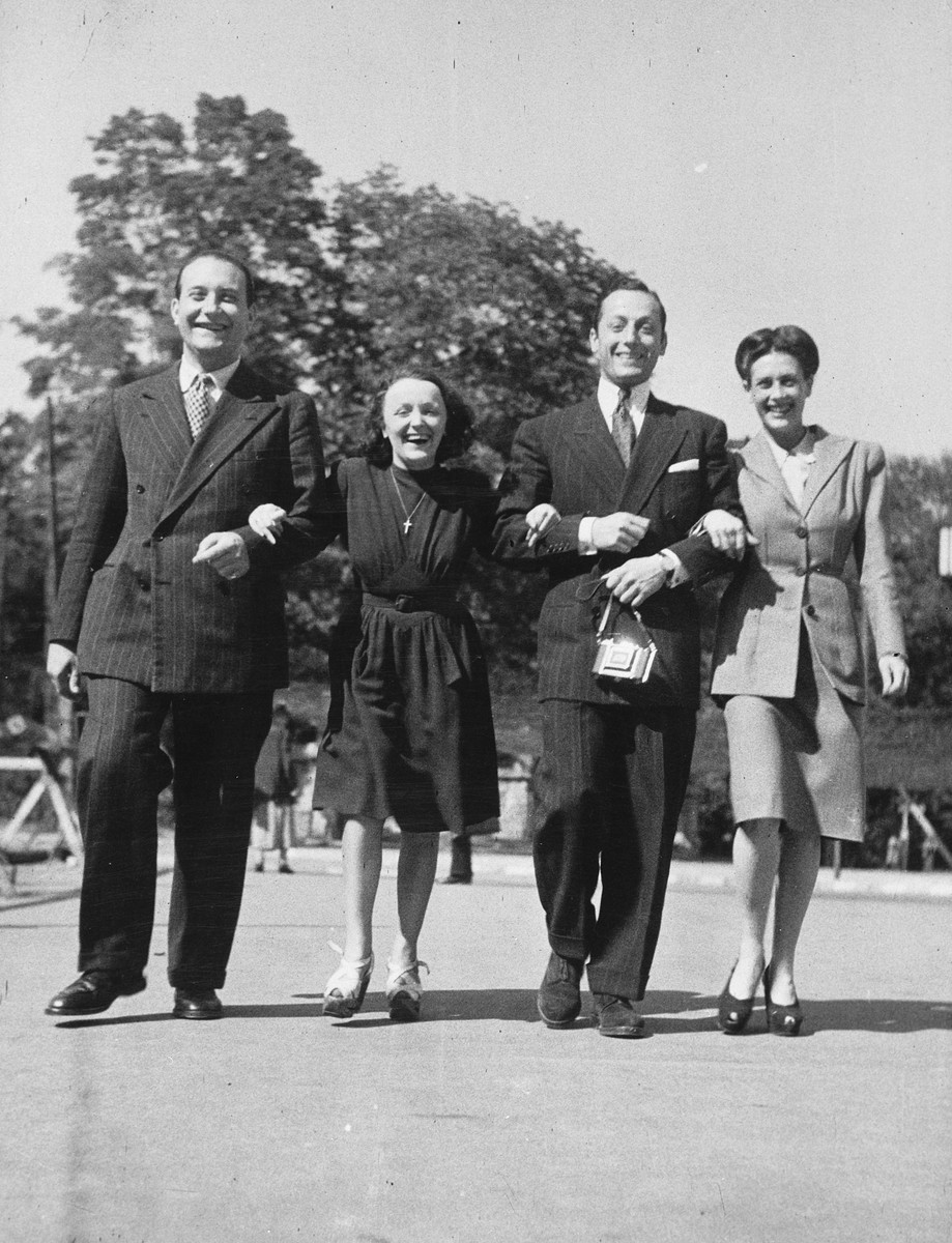 Four French performers dance across a street while on tour in Germany.  Edith Piaf is second from the left.  Sadie Rigal, who is actually a Jew in hiding, is on the right.  Next to Sadie is her dance partner, Frederic Apcar.