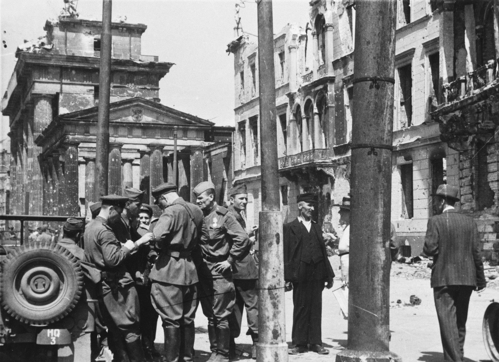 Red Army soldiers congregate on a street in Berlin after the fall of the city.