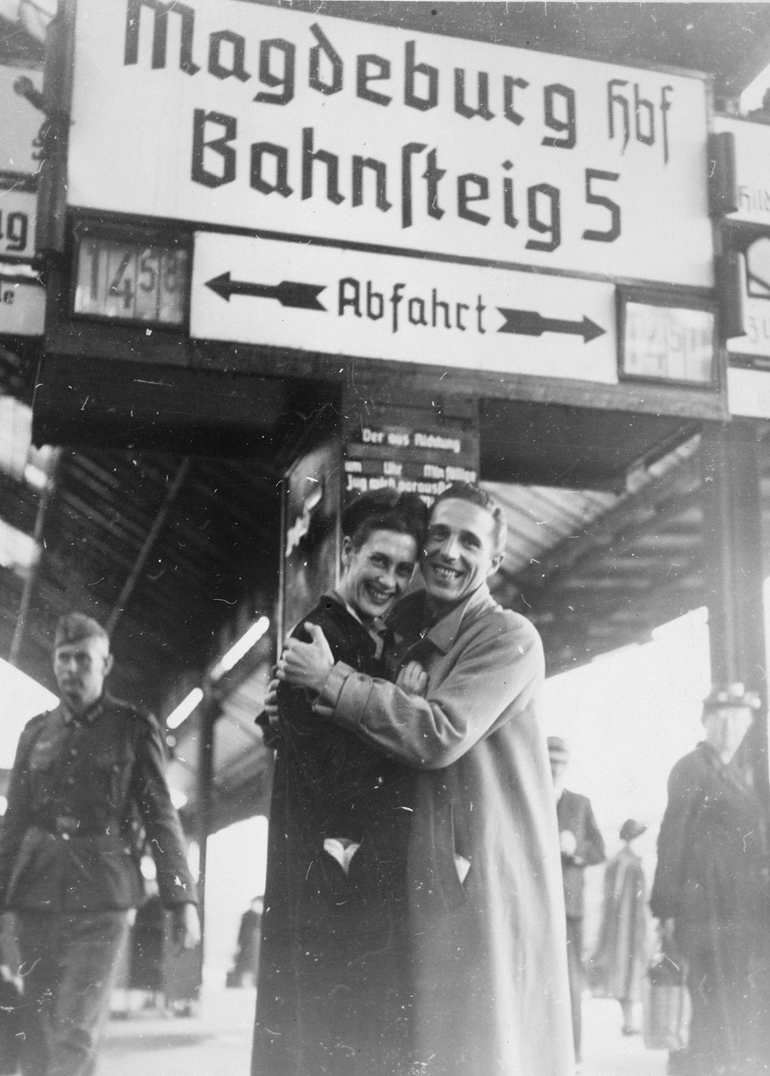 Two French dancers hug on a train platform while on a performance tour in Germany.  The woman, Sadie Rigal, is actually a Jew in hiding.  The man is her dance partner, Frederic Apcar.