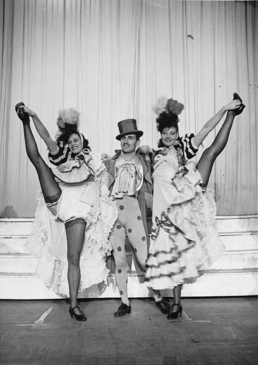 Three dancers, two of whom are Jews in hiding, perform in the Parisian music hall, the Bal Tabarin.  Pictured in the center is Piroska Sekely; on the left is Sadie Rigal.