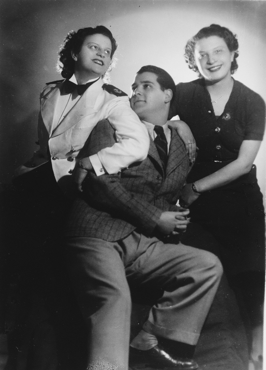Studio portrait of a Greek-Jewish family of musicians.  Pictured are Michel Assael and his cousins Neta and Frieda Berubi.