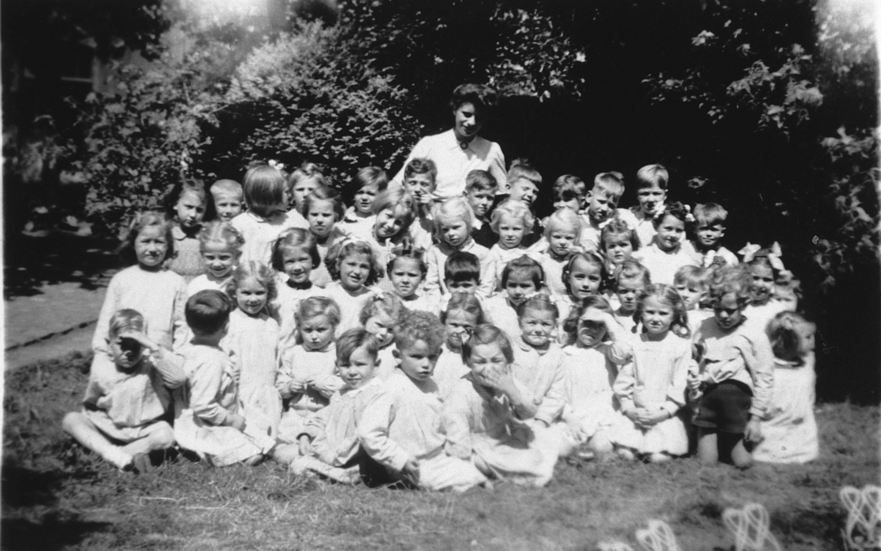 Group photo kindergarteners in a convent school in Belgium.  Among those pictured is a Jewish child survivor from Poland, Jeanine Ament.