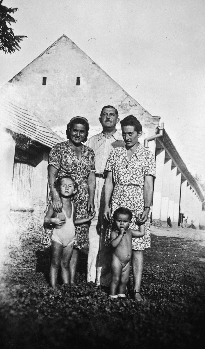 Polish refugees pose outside a building in Csillaghegy during the last year of the war.  Mania and her daughter Jeanine are pictured on the right.