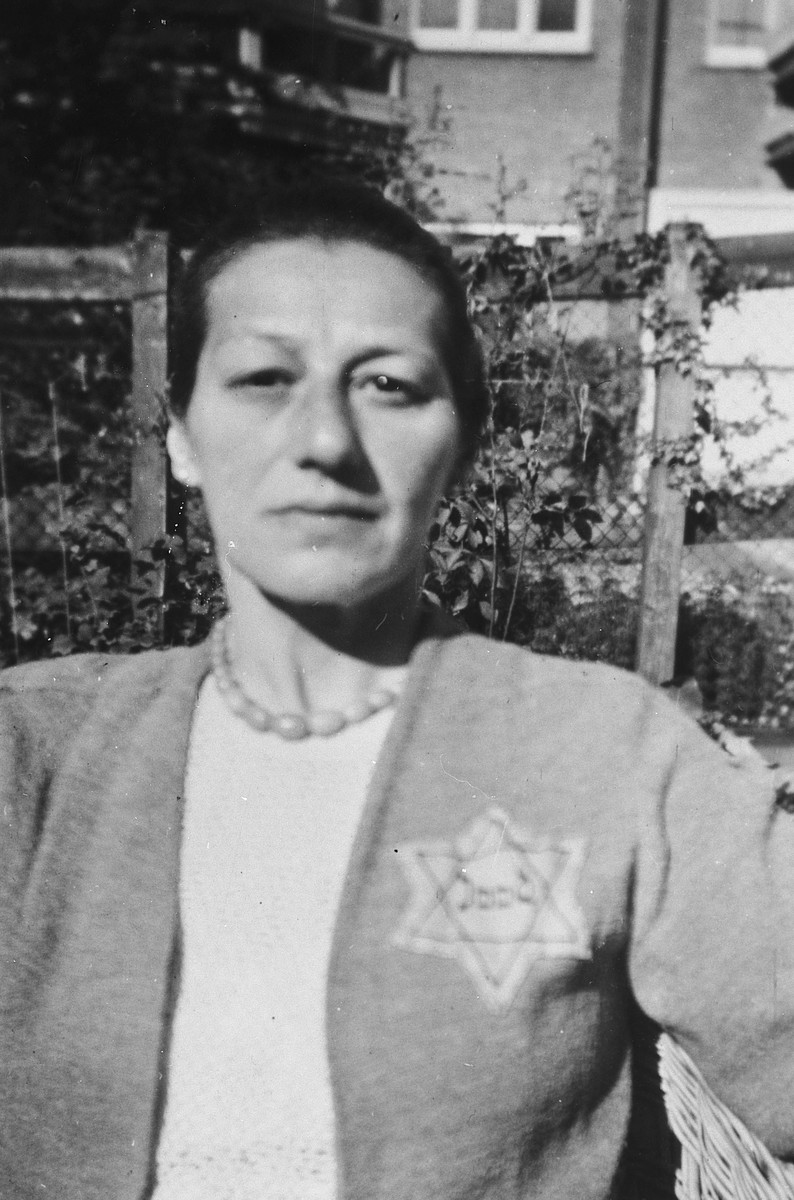 Portrait of a Jewish woman wearing a star of David taken shortly before she was arrested and sent to Westerbork.  Pictured is Lilly Weyl Zielenziger.
