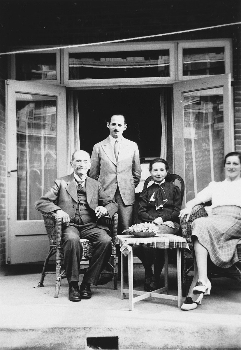 Two generations of German-Jewish emigres pose for a family portrait on the porch of their new home.  Pictured are Kurt and Lilly Zielenziger and Kurt's parents.