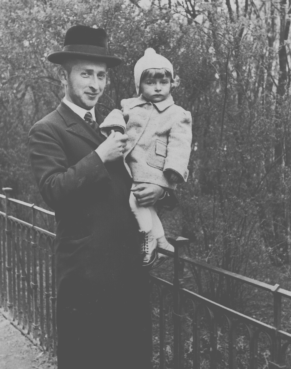 An Orthodox Jewish man poses with his small child in his arms.  Pictured is Jankel Stiel (a cousin of the donor's mother) and his child.  They were both killed in Belzec.