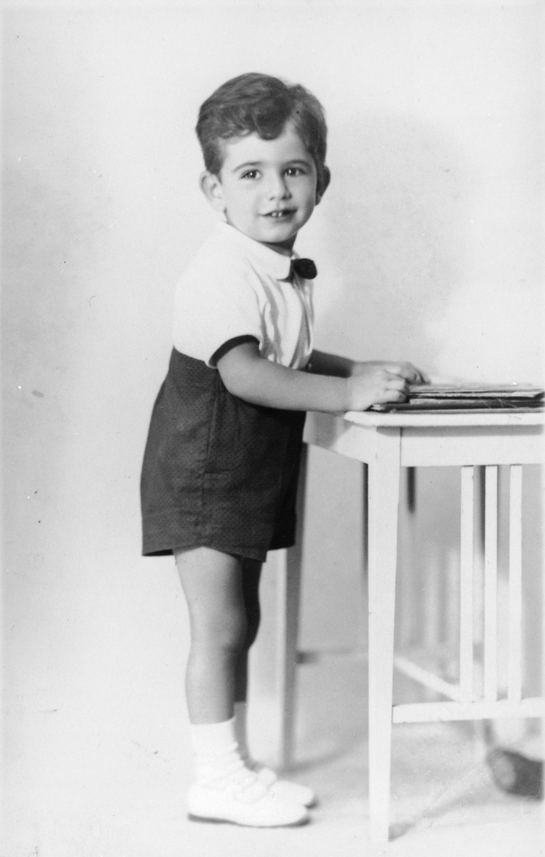 Portrait of three-year-old Tomas Kulka standing next to a table in Olomouc, Czechoslovakia.