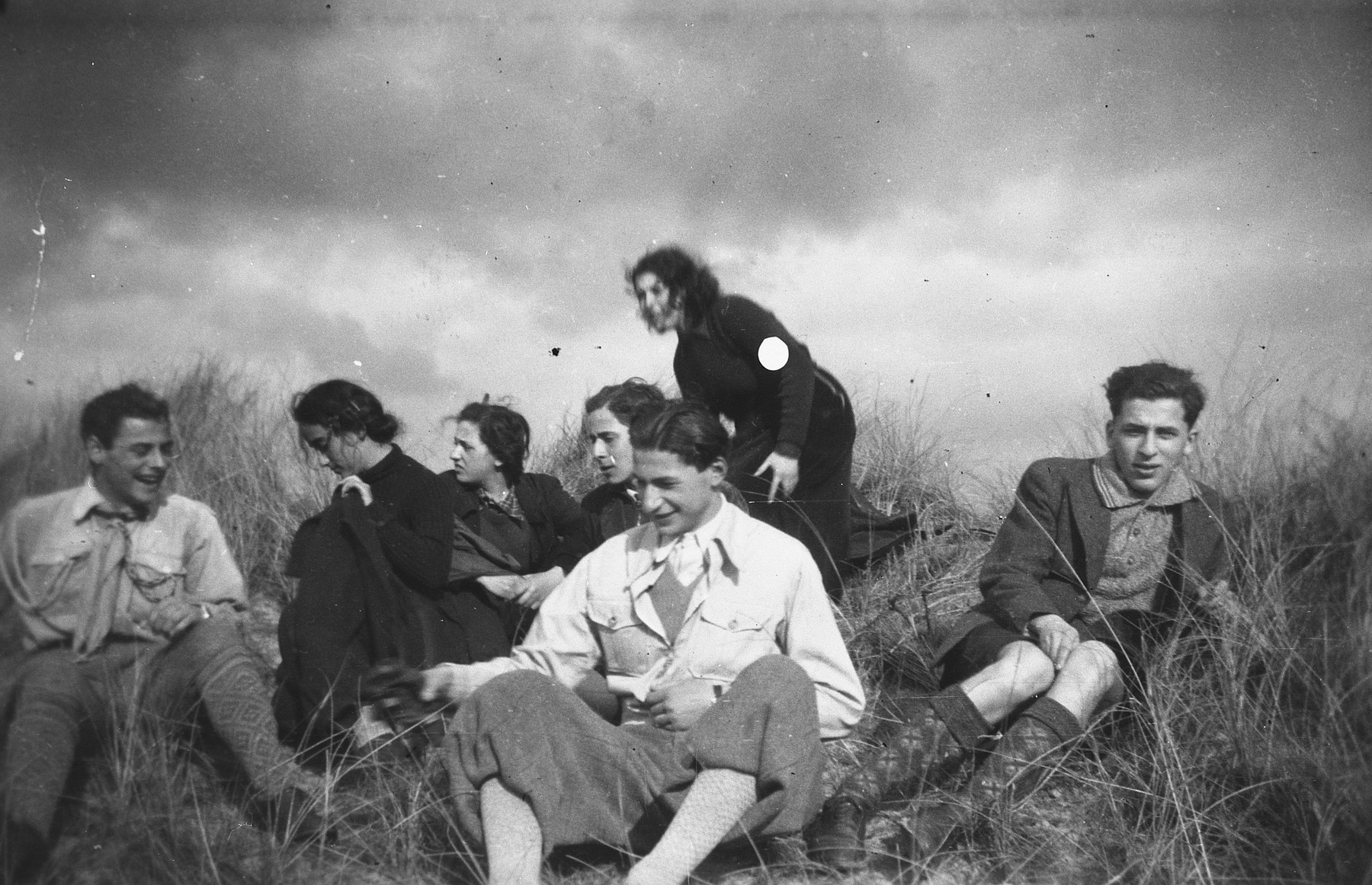 Members of Maccabi Hatzair rest in a field in the Netherlands.   Among those pictured is Erich Zielenziger.    [This photo is undated and may be wartime as Erich belonged to the group both immediately before and after the invasion.]