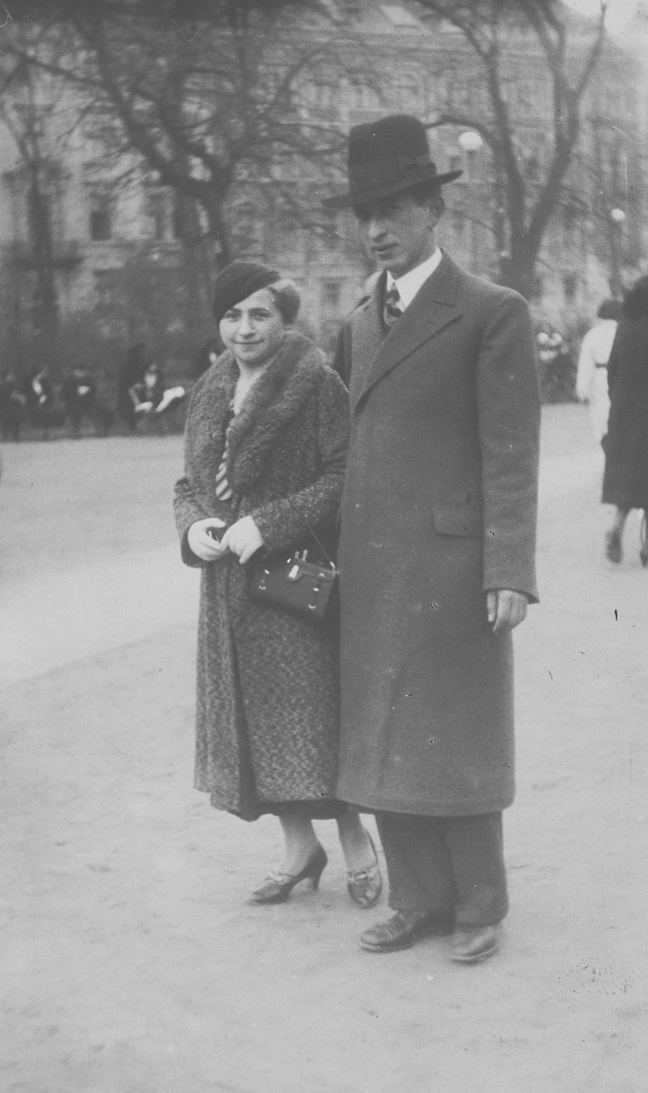 An Orthodox Jewish man poses with his mother on a street in Krakow.  Pictured is Jankel Stiel (a cousin of the donor's mother) and his mother Haya Stiel.  They both perished in Belzec.