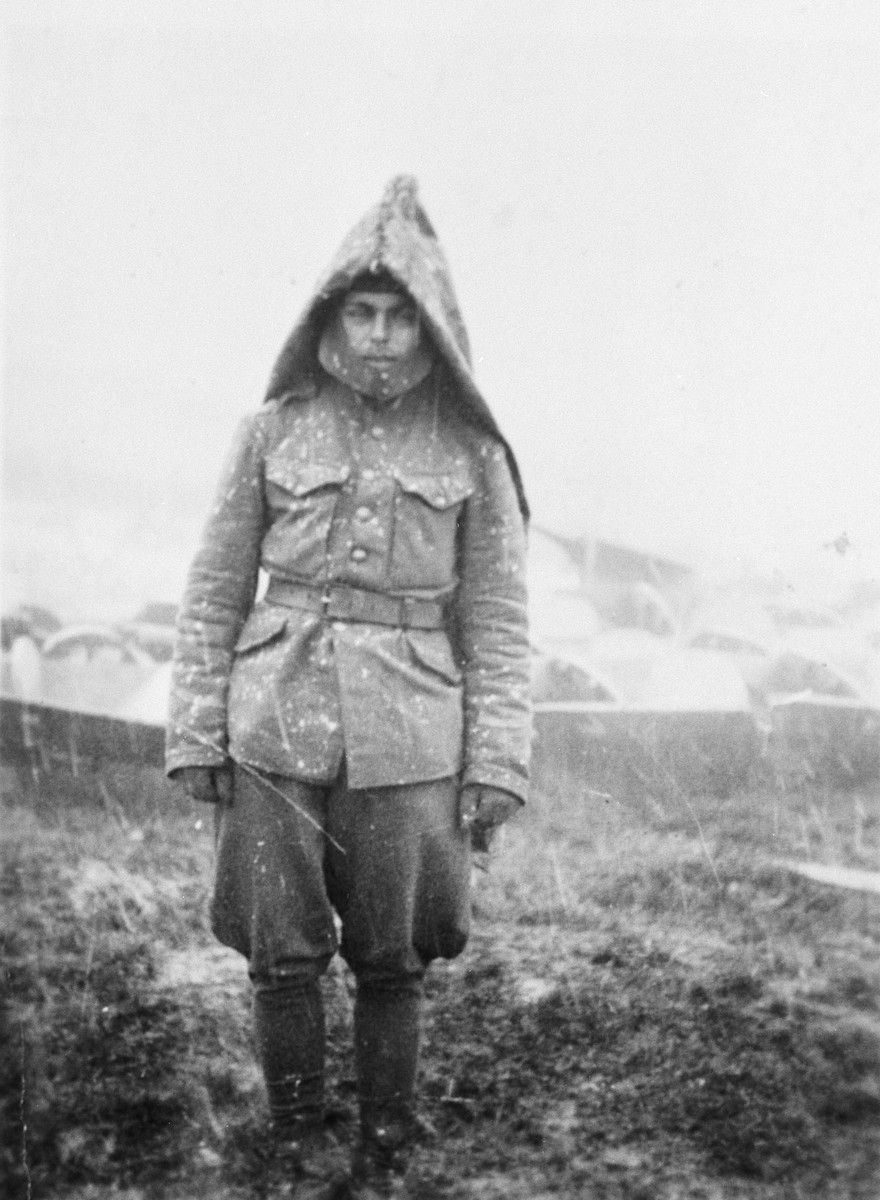 Close-up portrait of a Jewish conscript in a Hungarian labor battalion, dressed in a winter jacket on a snowy day.