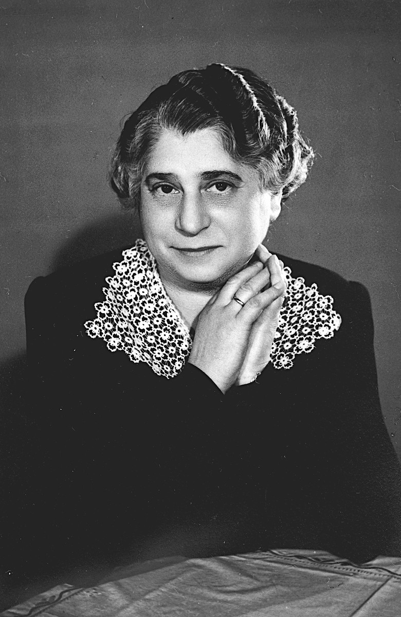 Studio portrait of a Hungarian-Jewish woman wearing a dress with a lace collar.  Pictured is Ilus Beke, the aunt of Denes Simonyi.  She survived deportation to Auschwitz.