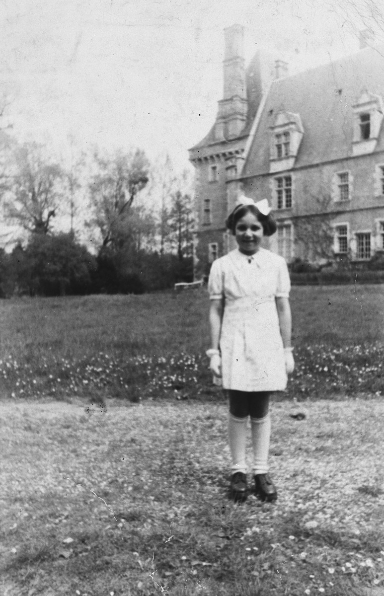 A French-Jewish girl poses outdoors in new clothing she received for a wedding in a public institution in Saint Amand en Puisaye, where she was in hiding.