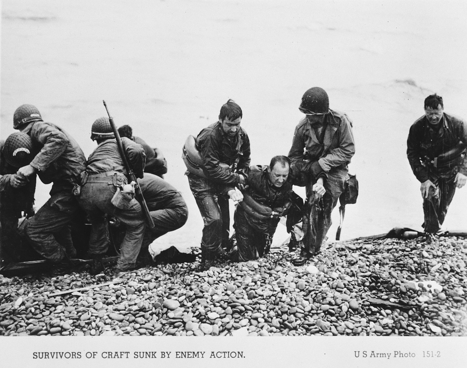 American troops pull the survivors of a sunken craft on to the shores of the Normandy beaches.