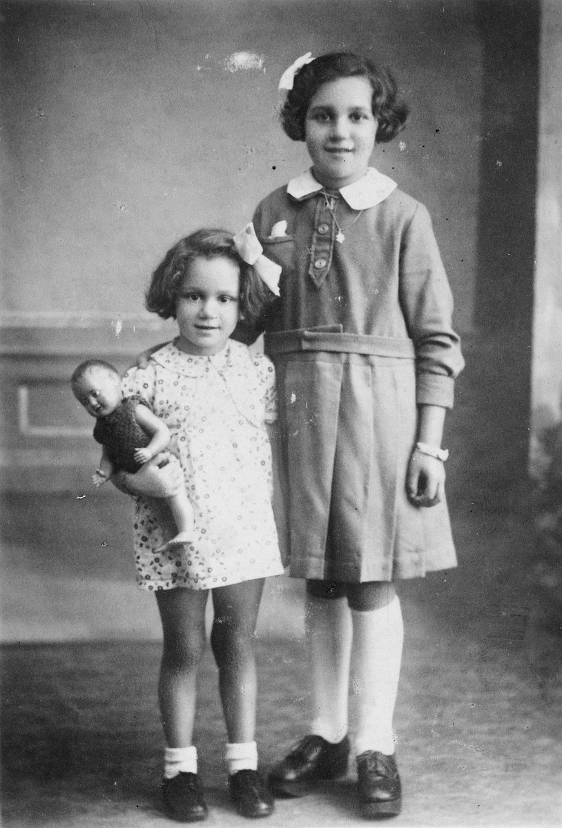 Post-war studio portrait of two Jewish sisters who had been hidden in separate institutions in France.  Pictured are Paulette and Nicole Szenker.
