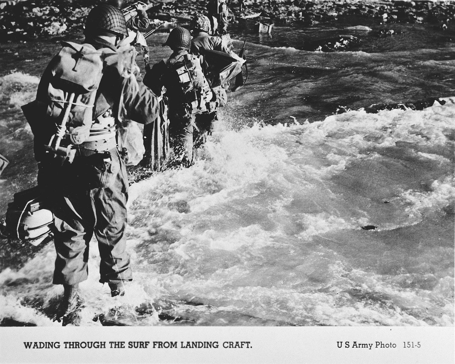 American troops wade through the surf on their arrival at the Normandy beaches.