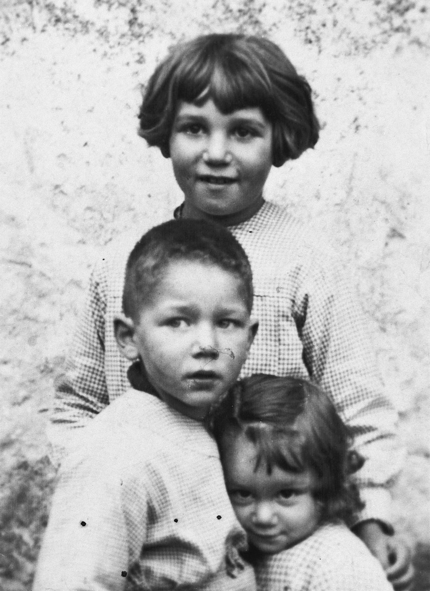 Portrait of three Jewish siblings taken shortly before they were taken into hiding.  Pictured are Paulette, Claude and Nicole Szenker.