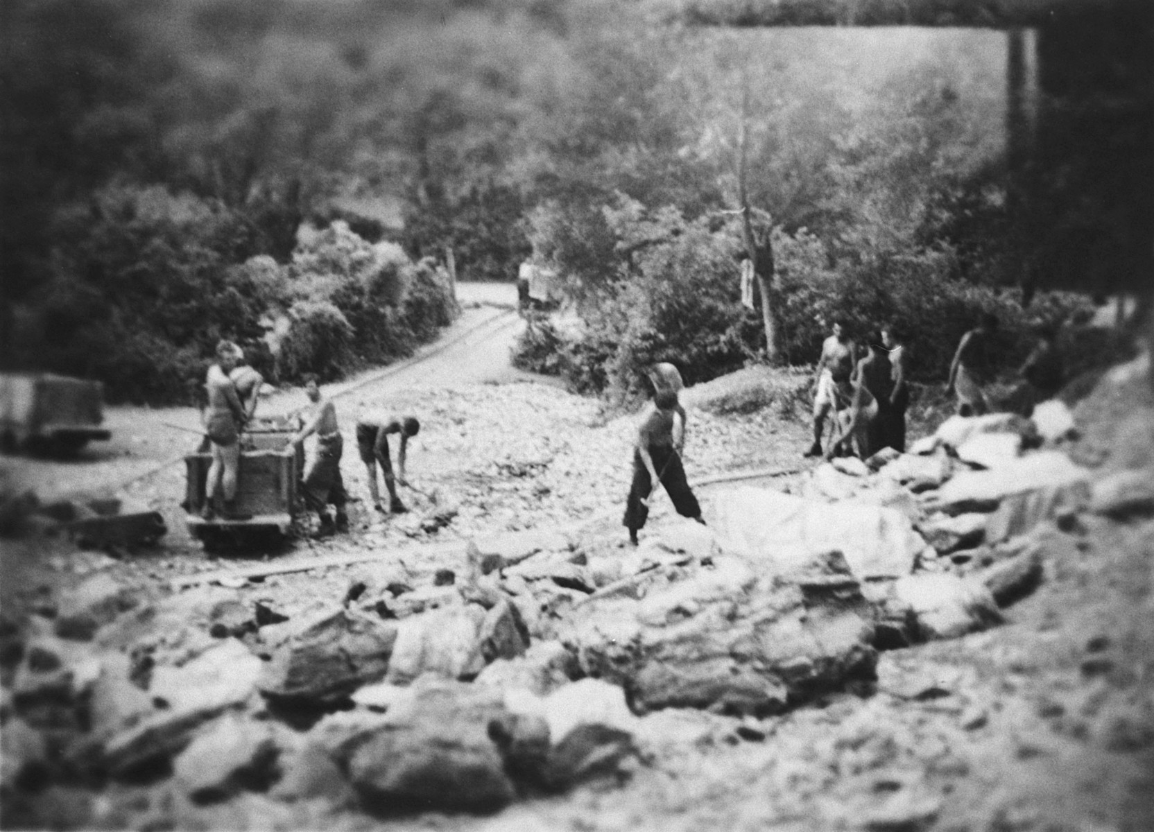 Members of a Hungarian forced labor battalion dig in a stone quarry.