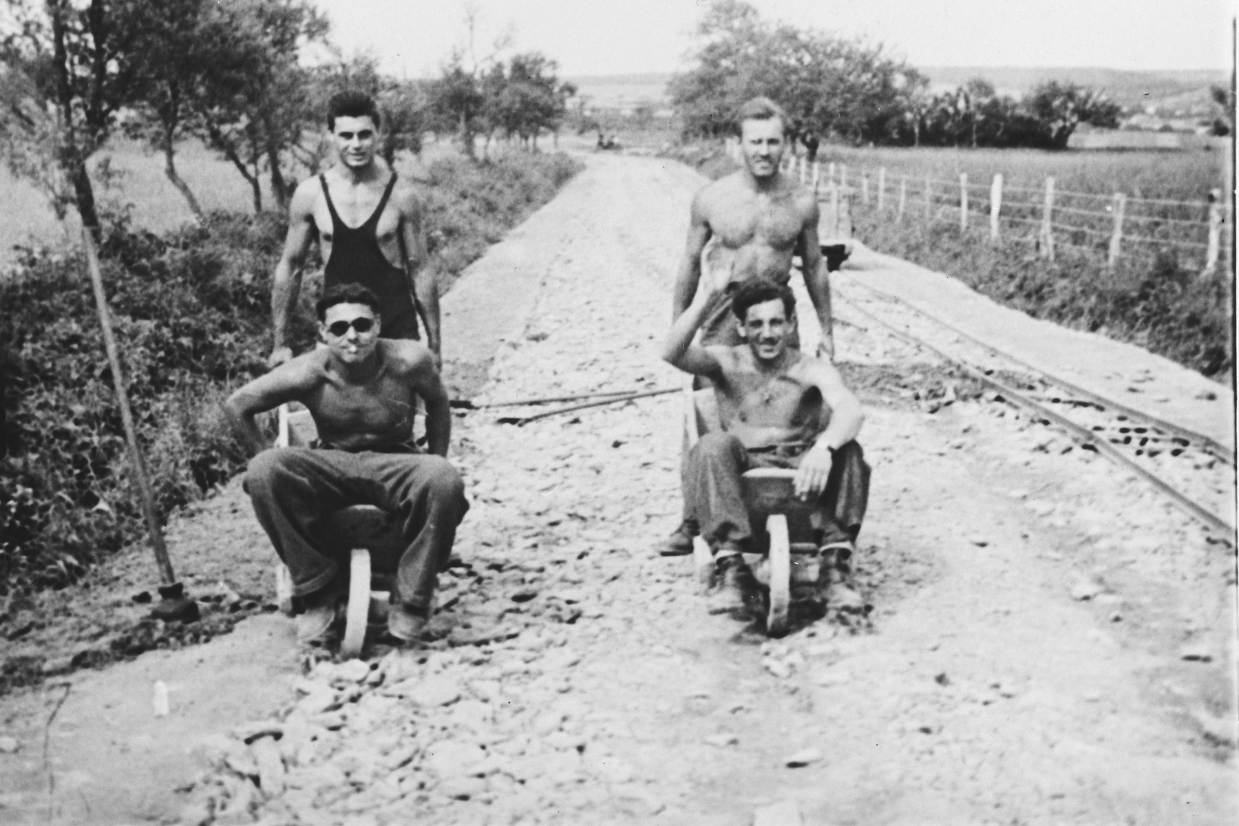 Members of a Hungarian labor battalion have a wheelbarrow race down a dirt road in Koszeg.