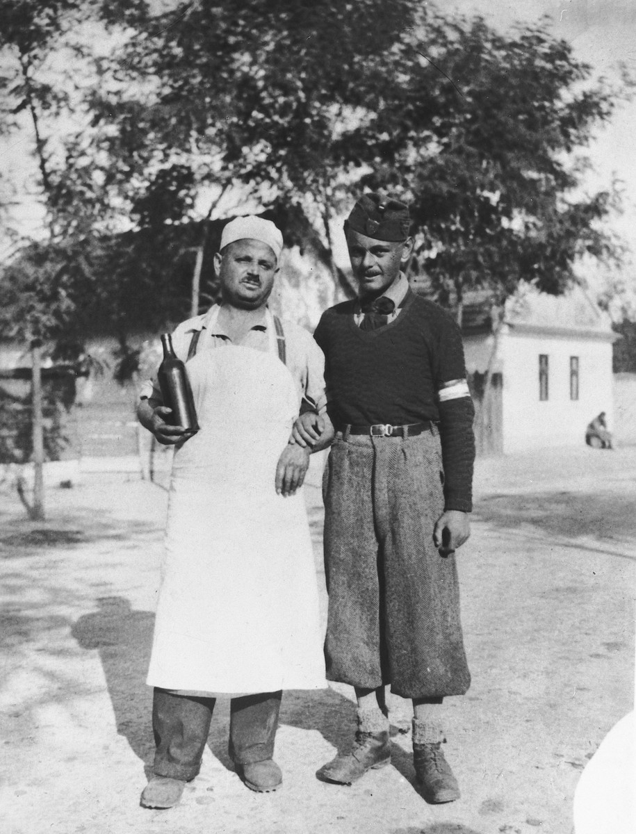 Close-up portrait of the cook Strasser and the company messenger of a Hungarian forced labor battalion.