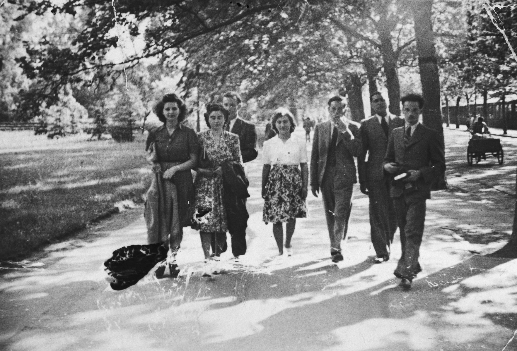 A group of Hungarian-Jewish friends, one of who was on forlough from a labor battalion, go for a walk in a park in Budpest.  Pictured are Eva Beke, Ica, Denes Simonyi, Dini, Erzsi, Fekete, and Anti.