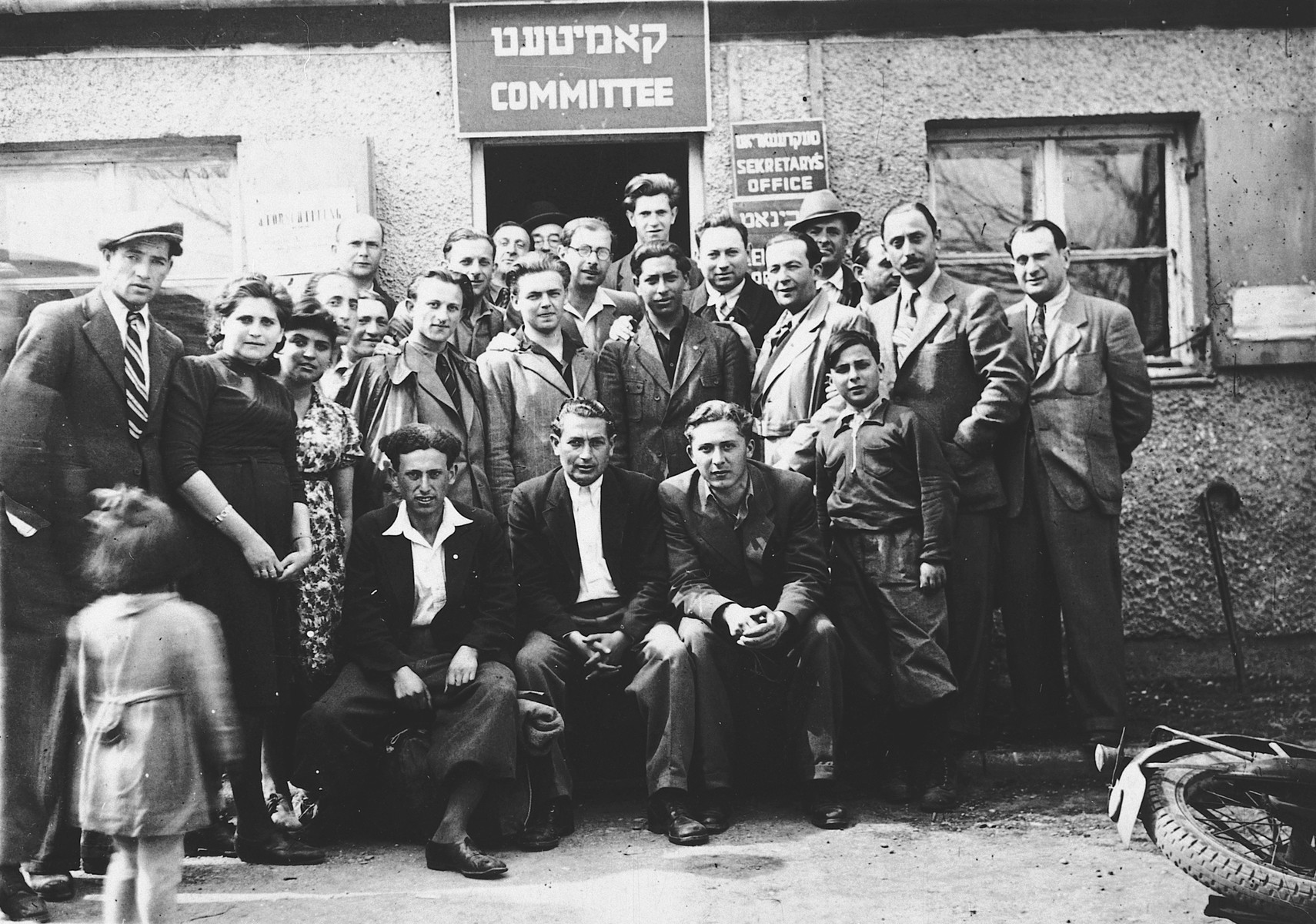 Jewish displaced persons pose outside the central administrative building in the Neu Freimann displaced persons' camp.