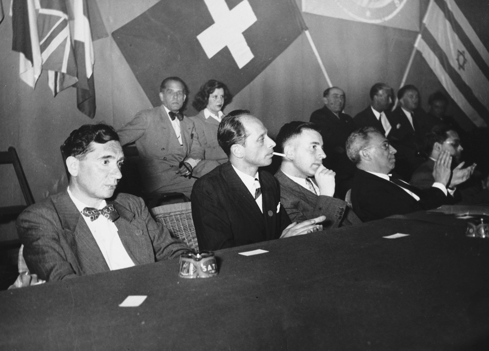 The Presidium at the opening session of the assembly of the World Jewish Congress in Montreux, Switzerland.   Among those pictured is Gerhart Riegner (in the first row the second from the left).