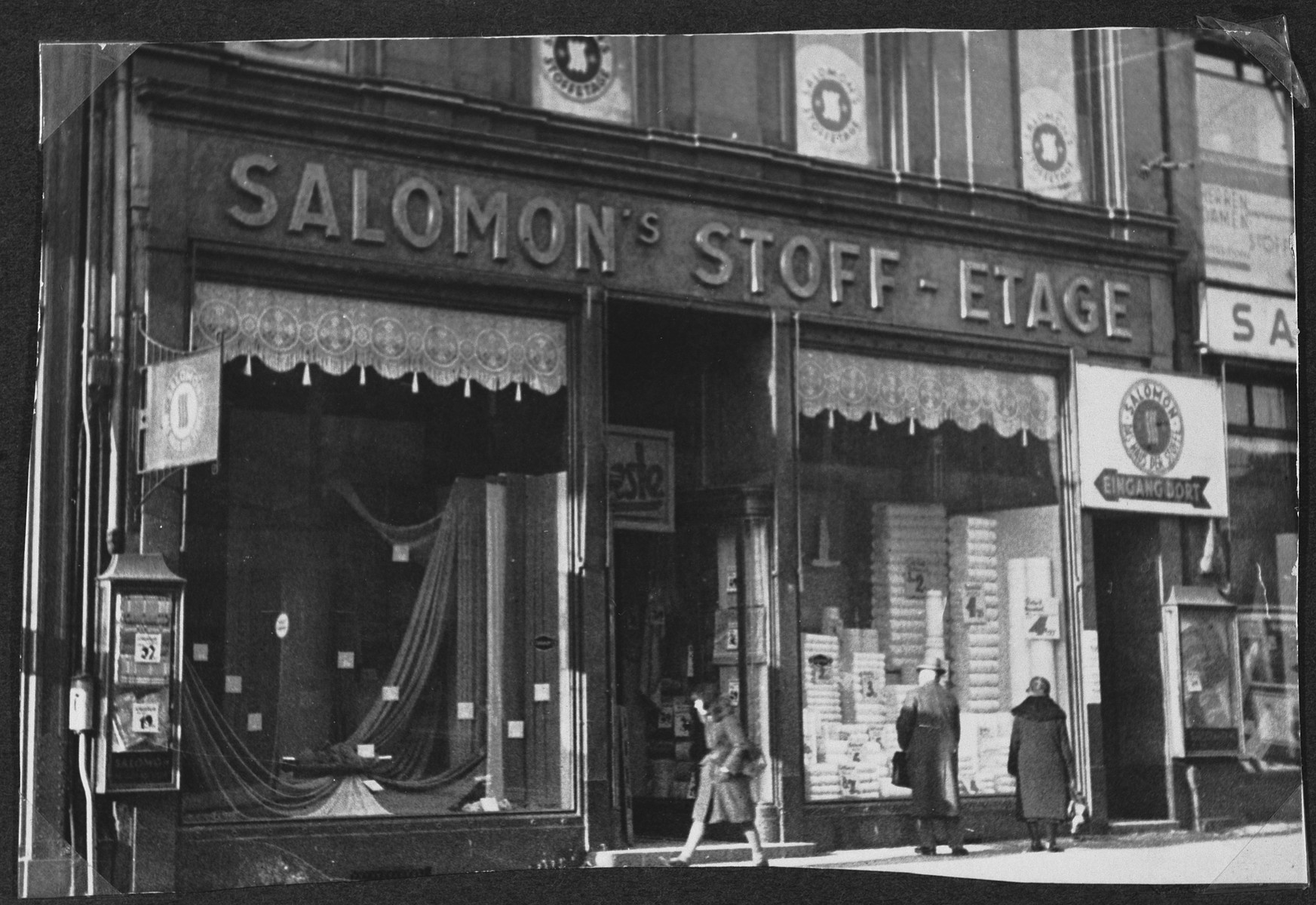 View of the store belonging to Simon Salomon, a French Jew, on a street in Paris.