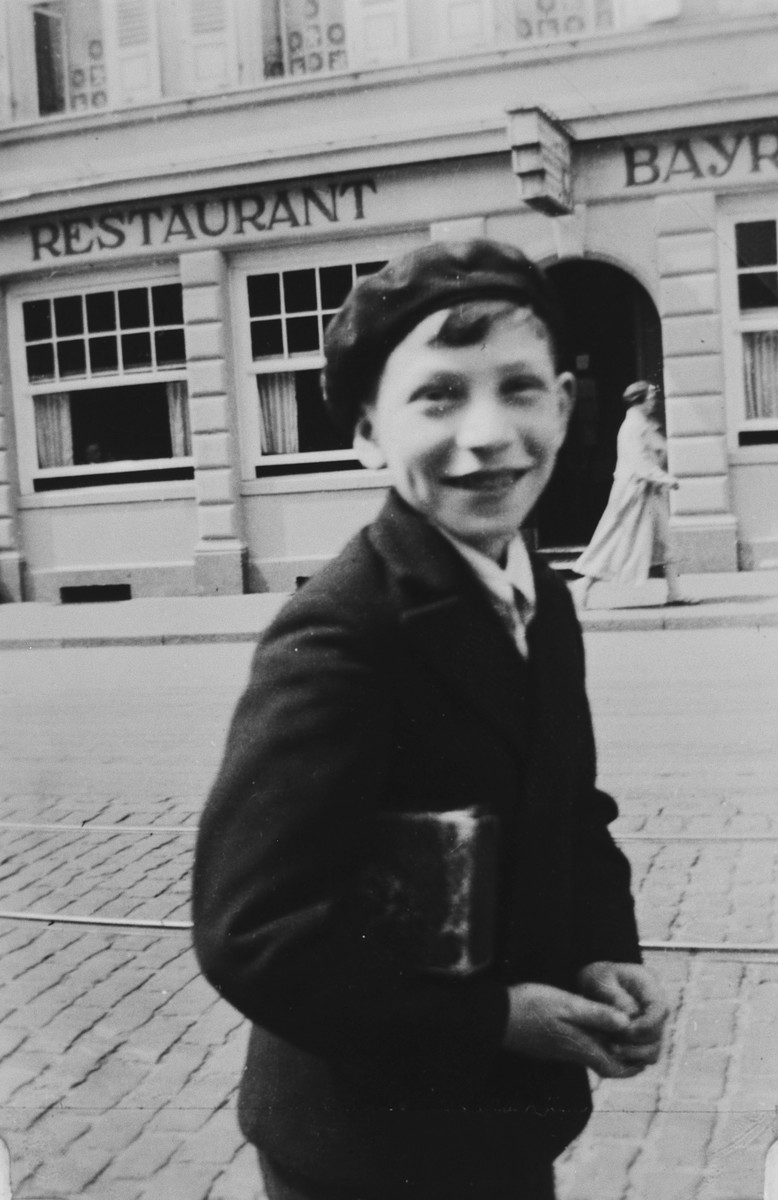 Erich Rothheimer, a German-Jewish teenager, poses on a street in Paris after emigrating from Germany.